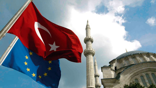 The flags of Turkey and the European Union in front of the Nur-u Osmaniye Mosque in Istanbul