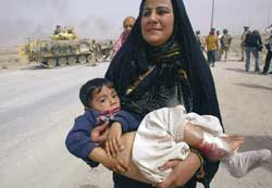 An Iraqi woman in Basra, holding her son wounded by a coalition bomb