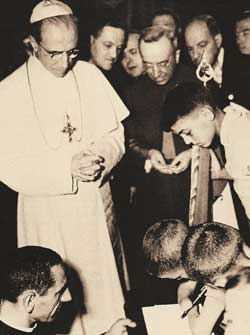 Pius XII in 1948 with some children mutilated by the war