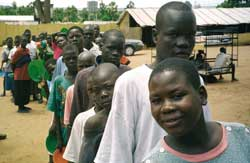 "Boys from Gulu on line to receive a meal from the ""Gulu Support the children Organization"", the organization which attempts to keep boys from being 