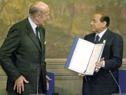 The President of the European Convention Valéry Giscard d'Estaing handing the draft of the Constitutional Treaty of the European Union to President of the Italian Republic Carlo Azeglio Ciampi and to President of the Council Silvio Berlusconi, 18 July 2003