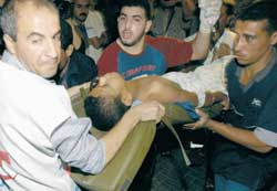 The first assistance to a Palestinian youth seriously injured during the Israeli raid on Gaza of 20 October 2003 in which eleven Palestinians were killed