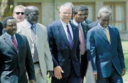 Colin Powell with the Kenya Foreign Minister Kolonzo Musyuka, the leader of the SPLA John Garang and the Vice-president of the Sudan Ali Osman Mohamed Taha, Nairobi 22 October 2003