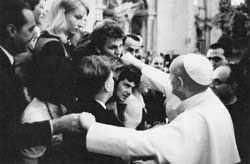 Paul VI greets a group of young people at the end of an audience