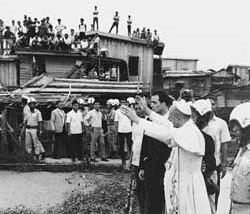 The Pope among the poor of the Tondo area of Manila, at the end of his journey to the Philippines in November 1967