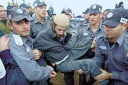 The arrest of a colonist by the Israeli police.