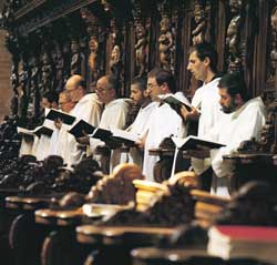 Cistercian monks in the choir of the abbey of Chiaravalle, Milan