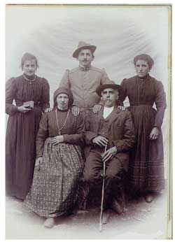 Above, standing, his mother Bortola Tancon and, seated, his maternal grandparents