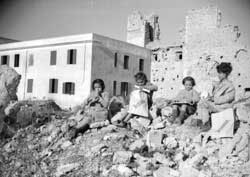 Some children of Cassino among the ruins of their houses destroyed by the battle