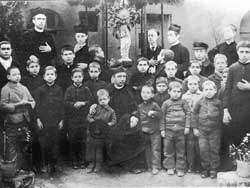 Father Annibale and some collaborators with the first group at the Antonian Orphanage for boys