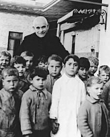 Don Orione with the orphans of the Piccolo Cottolengo of Claypole in Buenos Aires in Argentina, in 1935