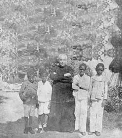 Don Orione with colored orphans in South America on his first trip in 1921-1922