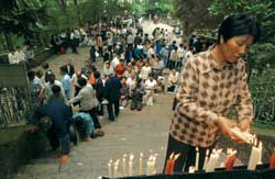 Faithful at prayer around the sanctuary of She Shan, near Shanghai, on the annual pilgrimage of 24 May