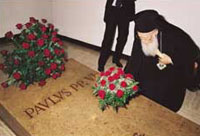 Patriarch Bartholomew I placing a bunch of flowers on the tomb of Paul VI in the Vatican Grottos, on the morning of 29 June