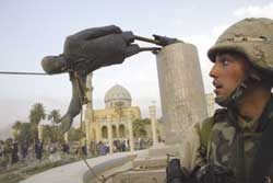 Baghdad, 9 April 2003. American troops pull down the statue of Saddam Hussein