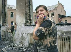 A woman in the rubble of the school in Beslan, after the dreadful attack that Spasskiy describes as the Russian 11 September