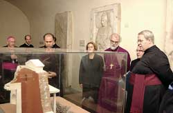 Rowan Williams in the Vatican Grottos in front of the relief model that reproduces the tomb of Peter, 4 October 2003