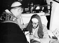 Paul VI greeting a poor invalid, a guest of the Latin Patriarchy of Jerusalem, during his trip to the Holy Land between 4 and 6 January 1964