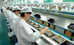 A factory making electronic products in Shenzen, in the southern province of Guangdong. In the firsy six months of 2004 China's GNP rose by  9,7% 