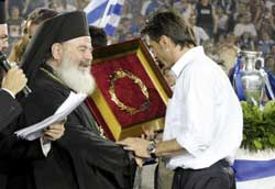 Archbishop Christodoulos greeting the Greek football team in Athens after their victory in the European championship on 5 July 2004