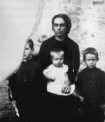 Tonini at three years old in his mother's arms