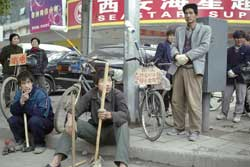Migrant workers on the streets of Peking. The Chinese economic reforms have produced a growing income differential