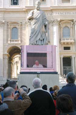 The large screen set up in Saint Peter's Square during the Angelus recited from the Gemelli hospital