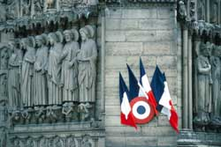The French cockade and flags on the Cathedral of Notre Dame in Paris