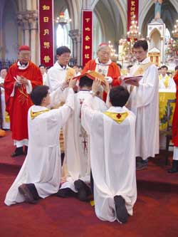 Bishop Aloysius Jin Luxian places the Bible on the head of Joseph Xing Wenzhi during his episcopal ordination which took place on 28 June last