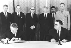 The American Ambassador Llewellin E. Thompson and the Soviet Minister of Foreign Affairs Andrei Gromyko sign the Nuclear Non-Proliferation Treaty, the NPT, Moscow, 1 July 1968