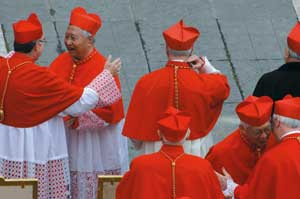 Cardinal Nicholas Cheong Jinsuk, second from the left, greeting other members 