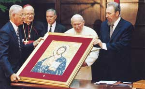 John Paul II during his visit to Cuba in January 1998, presents Fidel Castro with the reproduction of the mosaic of Christ in the Niche of the Pallia in the Vatican Grottos.