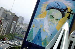 Teheran. Above, a glimpse of the bell tower of a church and a mural portrait of the Ayatollah Khomeini