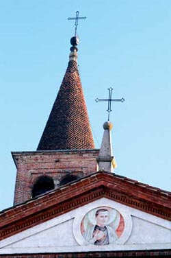 The bell tower and tympanum of the church of Trivolzio