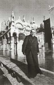 Cardinal Albino Luciani crosses Saint Mark's Square inundated by the high water