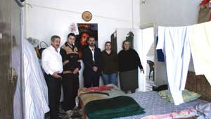 A family of  Iraqi refugees in their room in the Massaken Barzi district