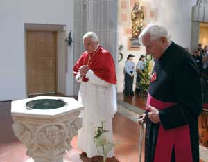 Benedict XVI with his brother Georg visiting the parish church of Sankt Oswald, in Marktl am Inn, his birthplace, 11 September 2006