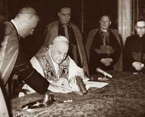 John XXIII while signing the Encyclical Pacem in terris, on 9 April 1963