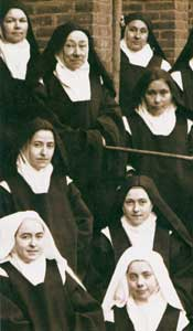 Sister Teresa of the Child Jesus (second row from the bottom, on the right) and Sister Genevieve of the Holy Countenance (first row from the bottom, on the left) in a group photo taken on Easter Monday, 15 April 1895