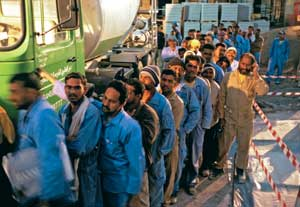 Asian immigrants at work in the United Arab Emirates. They are mostly Christian