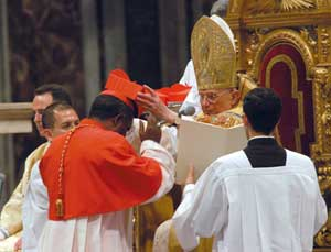 Benedict XVI placing the cardinal's biretta on John Njue, 24 November 2007