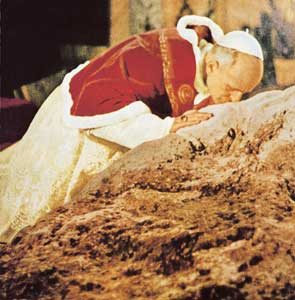 Paul VI kissing the rock where Jesus entrusted the primacy to Peter