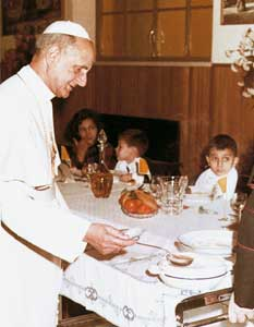 "Paul VI serving lunch to the young winners of the  ""Crib Competition"" on 30 January 1966"