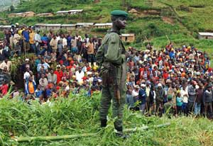 A Congolese soldier checking a group of people fleeing the clashes between the regular army and rebel militias in North Kivu. Despite the Goma agreements in January, the area is not peaceful: according to the UN, a struggle is going on between militias for control of the illegal mines