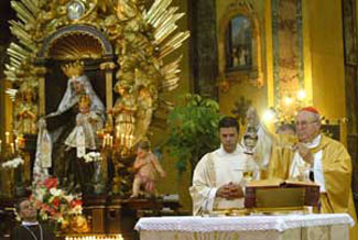 Cardinal Agostino Vallini celebrates the first mass as the Pope's Vicar for the diocese of Rome 13 July 2008 in the parish of Santa Maria in Transpontina, in which Our Lady of Mount Carmel is venerated