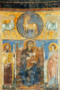 Details of the frescos of the apse of the Church of San Silvestro in Tivoli, Rome. Above, on the central axis of the drum the Incarnate Word appears in the arms of the Virgin Mary and, above, the Lamb  with a cruciform halo who sheds blood from his side, 