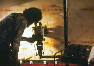 The scientist Samuel F. Pellicori examining the Shroud through a stereomicroscope