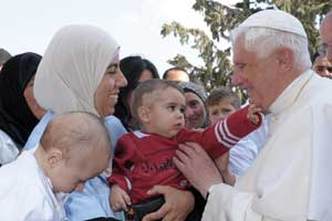 Benedict XVI greeting the children of the Caritas Baby Hospital, Bethlehem, 13 May 2009 [© Osservatore Romano]