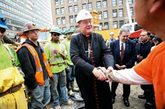 The Archbishop of New York Timothy Dolan with the workers on the construction site of the new subway [© Associated Press/LaPresse]