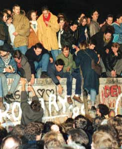 Hundreds of Berliners climbing over